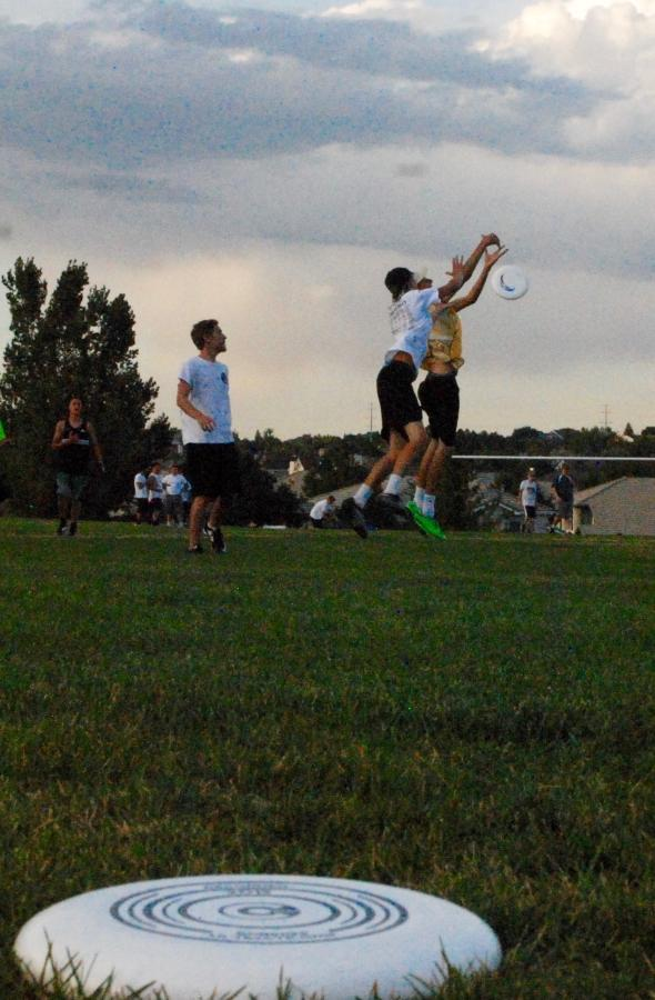 Thomas Otterstetter '18 leaps for the Frisbee during during the Ultimate Frisbee game Thurs. Sept. 15 at Wildcat Elementary.