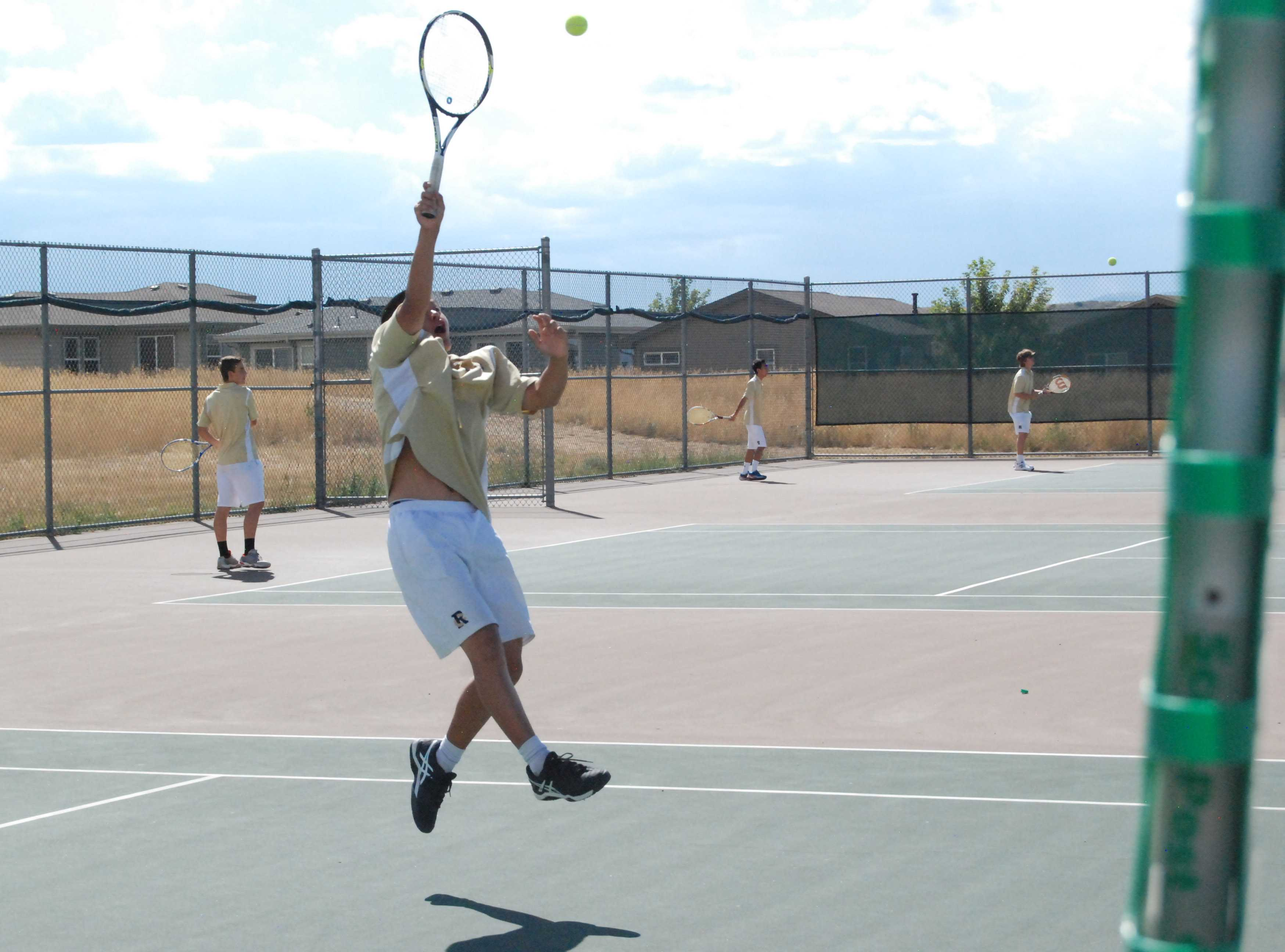 Will Kong '18 returns a volley during his match Tuesday against Mountain Vista. Will lost his match 6-4 6-4.
