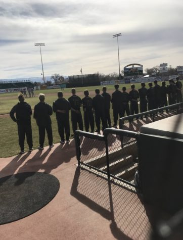 The team lines up for the National Anthem Thursday Mar. 9 against Fruita Monument.