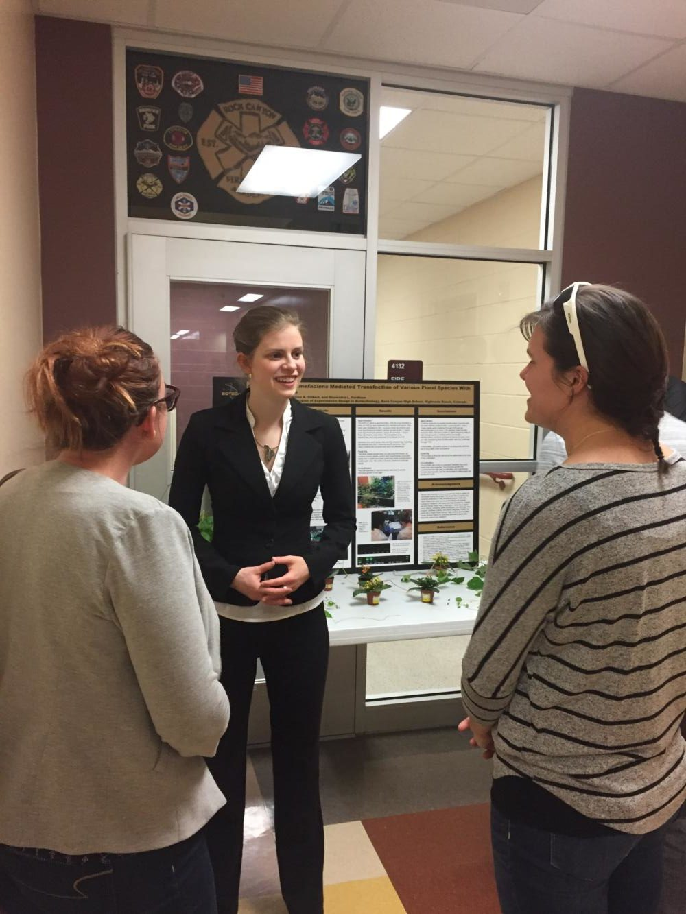 Tina Gilbert '17 explains her research to friends and family during the symposium on Thursday, May 4.