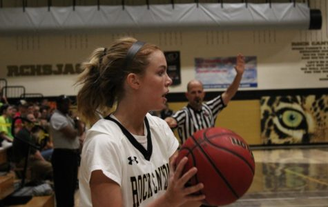Hailey Hill '18 prepares to throw the basketball back into play, Sat.,Jan. 27.
