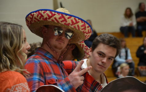 Seniors Mitch Mullen and Dalton McKeel show off their fiesta-themed gear in honor of senior night during the boys varsity basketball game at home against Castle View High School, Wednesday, Feb. 14.