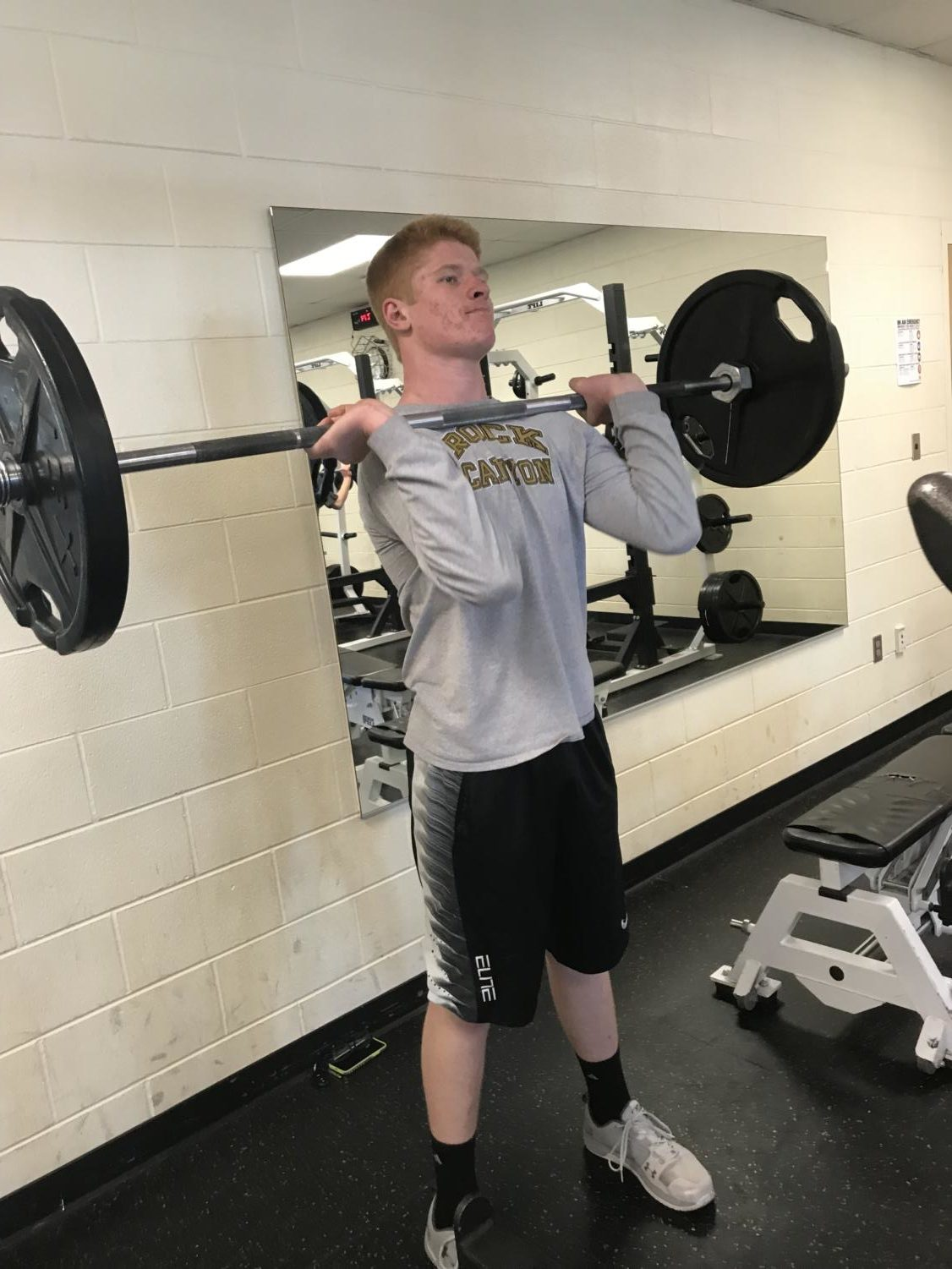 Colton Macleod '19 performs a hang clean during football offseason workouts, Fri., Feb 9.