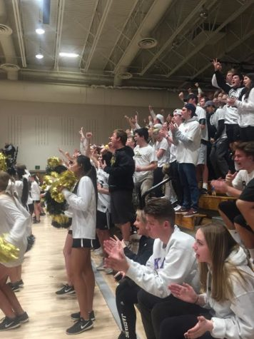 The student section anticipates a three pointer during the Wednesday night Sweet Sixteen game, Feb. 28, against Eaglecrest High School.  After a hard-fought game and one overtime, Rock Canyon boys varsity basketball won the game 65 to 64. (March 1, 2018)