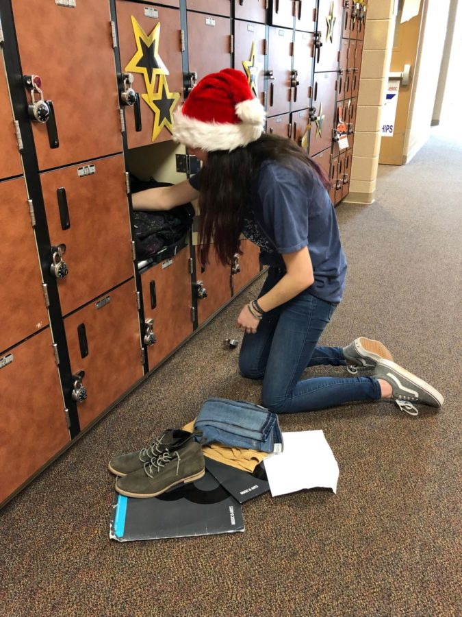 """Junior Jessica Rumsey cleans out her band locker as part of her New Year's Resolution Jan. 8. Rumsey has decided that in the new year she is going to be more organized and is hoping to stick with it throughout the year.""""My New Year's Resolution is to stay more organized because I think it's in my nature to be disorganized. I hope that my friends will help keep me honest, but I will keep up with my resolution mainly by making sure that I put things back once I am done using them,"""" Rumsey said."""
