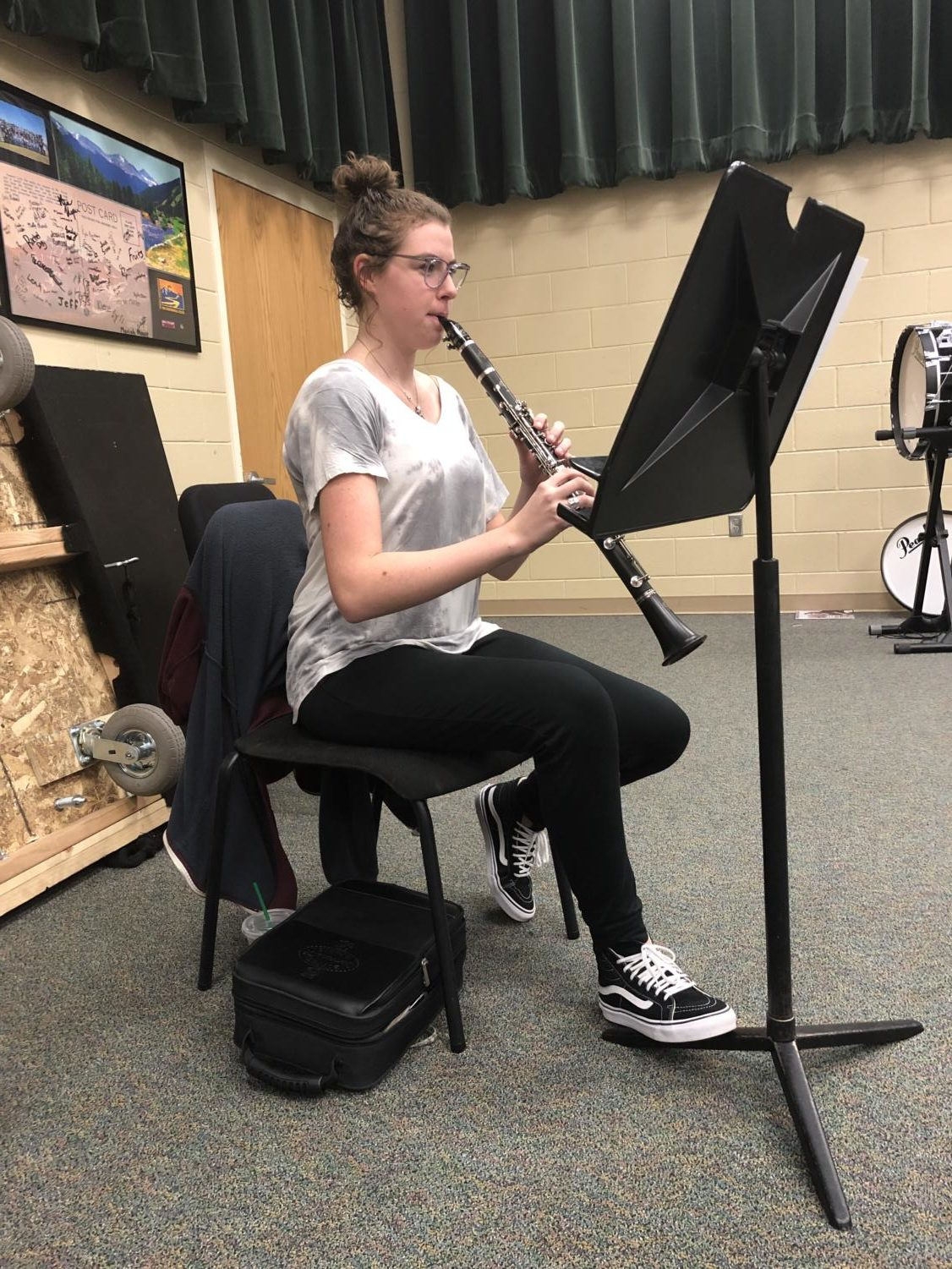 "Emily McDonald '19 practices her clarinet during access in the band room Jan. 10. McDonald received the music after being accepted into the Colorado All State band and practiced before the combined musical rehearsals. ""I am most excited to meet other players from around the state that have worked just as hard to get here and are just as excited about music as I am. As the best in the state changes, the community of musicians chosen is unique to any year prior and I'm really excited to meet this years members,"" McDonald said."