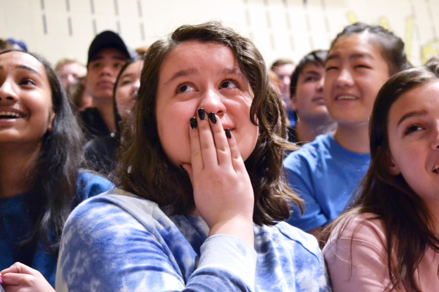 Sara Smith '21 cries while watching the introductory video introducing last year's wish kid, Violet March 1, 2018.