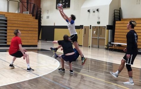 Francesco Reiff '19 jumps over teammates to set the ball. Reiff used to live in a town that could barely make a volleyball team from how little people were interested.