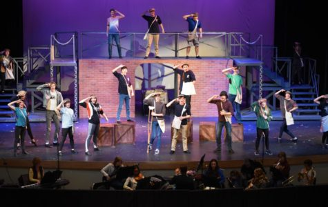 "The cast of Newsies rehearses after school in the auditorium Feb. 20. The cast, crew, and pit members have been working since the end of December to put the production together. ""I play the part of Joseph Pulitzer and it's fun being a part of a family."" Lily Schmoker '19 said."