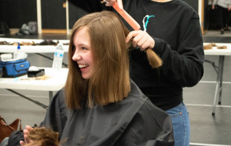 Julia McDonald '21 laughs after getting her hair cut during the Dare to Share event Tuesday, March 5. 102 pony tails were donated in four hours.