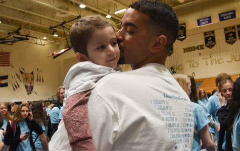 Michael McGuire lifts and kisses his son, Wish Kid Michael McGuire during the closing assembly in the gym March 8. The closing assembly celebrated Michael and his wish to go to Disney World.
