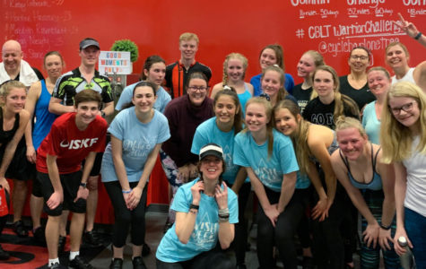 After attending a spin class at Cycle Bar Lone Tree, a collection of students and faculty pose outside the bike studio March 2. French National Honor Society sponsored the spin class as a way to raise money for Wish Week. Bikes were $25 a person and FNHS raised $550 from the 45-minute class.
