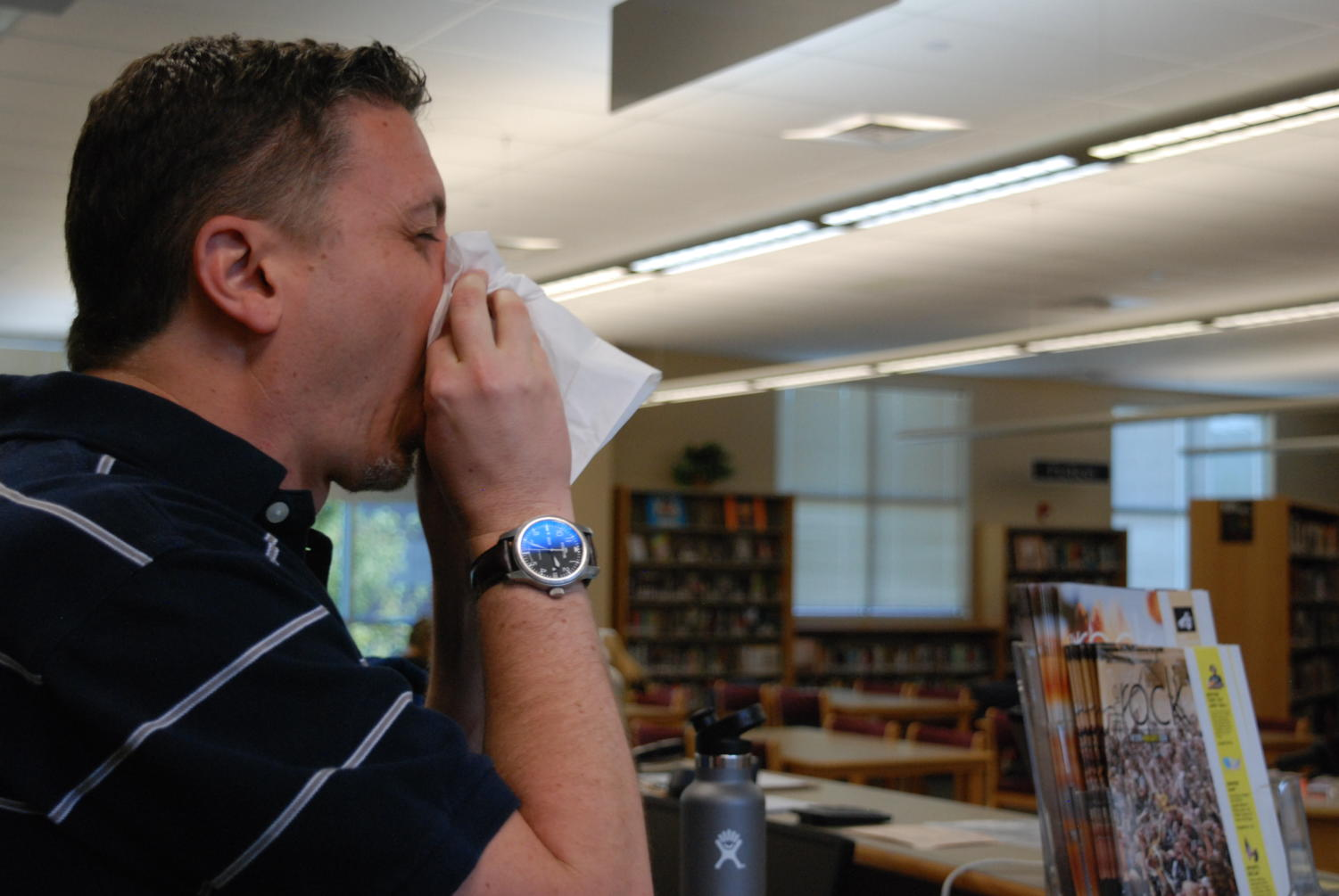 Mr. Winkleman blowing his nose during seventh period in the library.