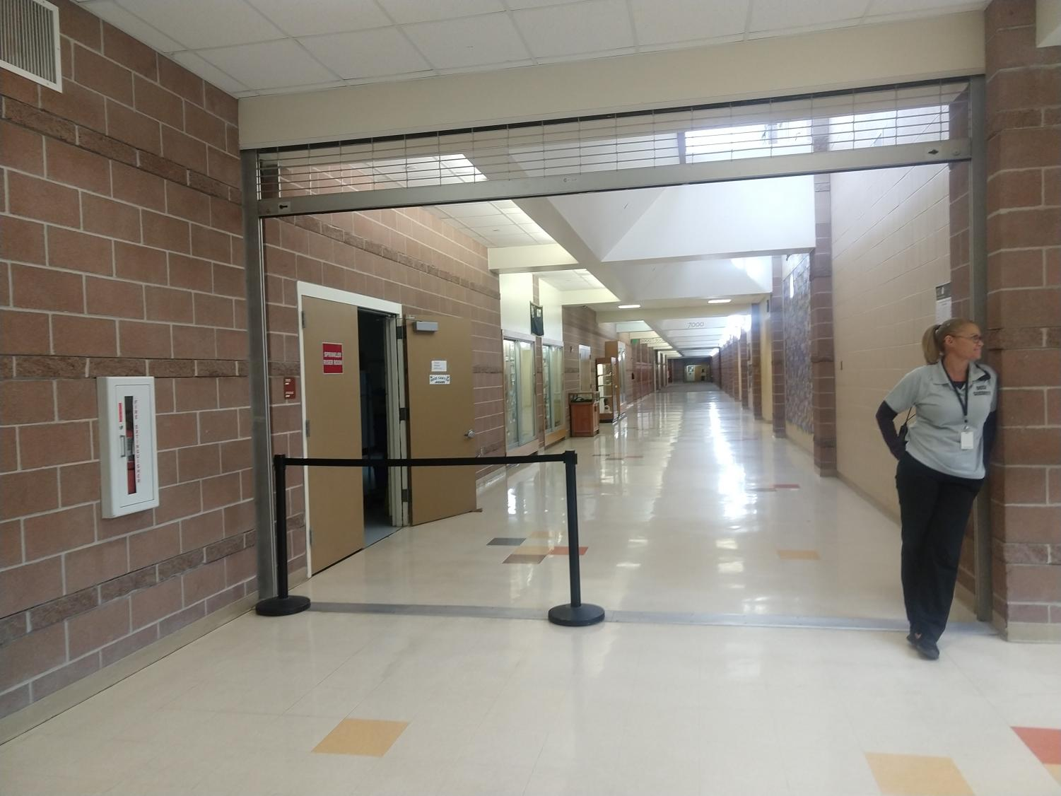Security Guard Melinda Schulz guarding the hallways from Students. Jan. 9.
