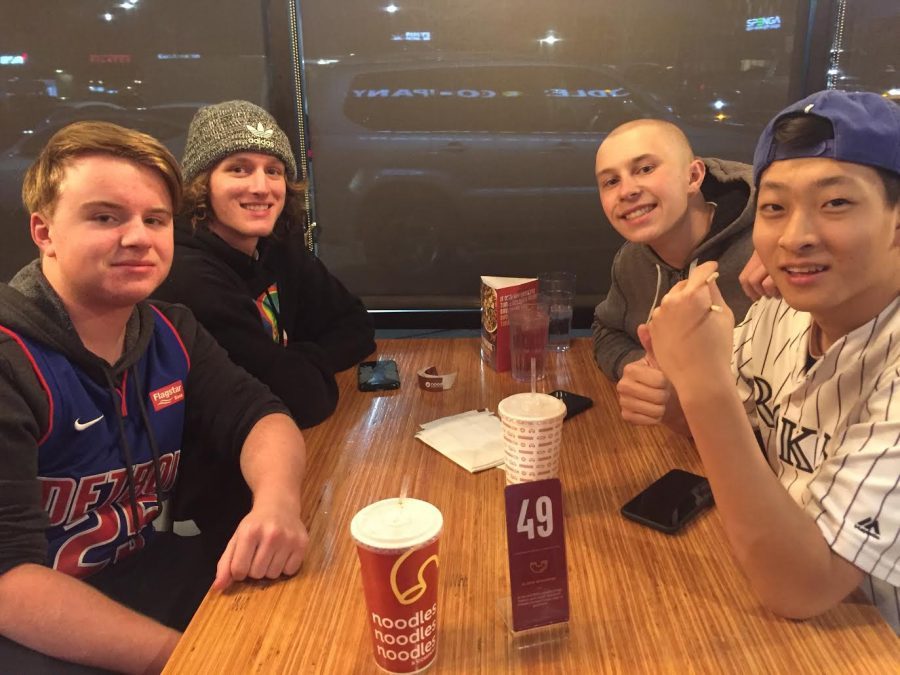 Nathan Engler '21, Jack Keough '21, Aidan Chung '21 and Brett Birtzer '21 pose for a photo while waiting for their food at Noodles & Company Feb. 27. Engler, Keough, Chung and Birtzer have been to all the Dish for a Wish restaurant starting from Friday's Jersey Mikes to Thursday's Noodles & Company.