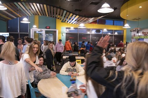 Students wait to order and eat at Costa Vida, as part of the Dish for a Wish event March 4, 2019.