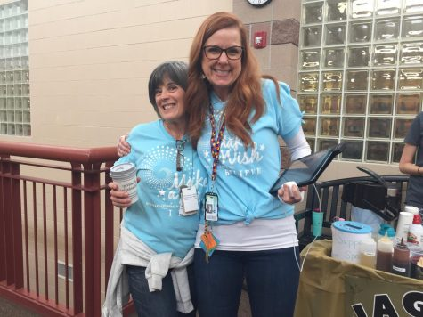 Educational Assistants Kathy Gallo and Kandi Hedges pose in their 2013 Wish Week shirts outside of the 3000s Feb. 19. This is Gallo