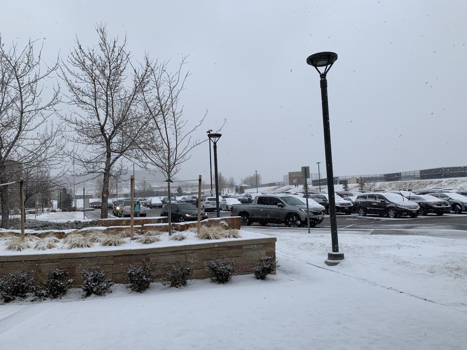 Snow covers the upper parking lot at 2:48 pm Feb. 3. All after school activities were cancelled due to predicted, dangerous road closures.