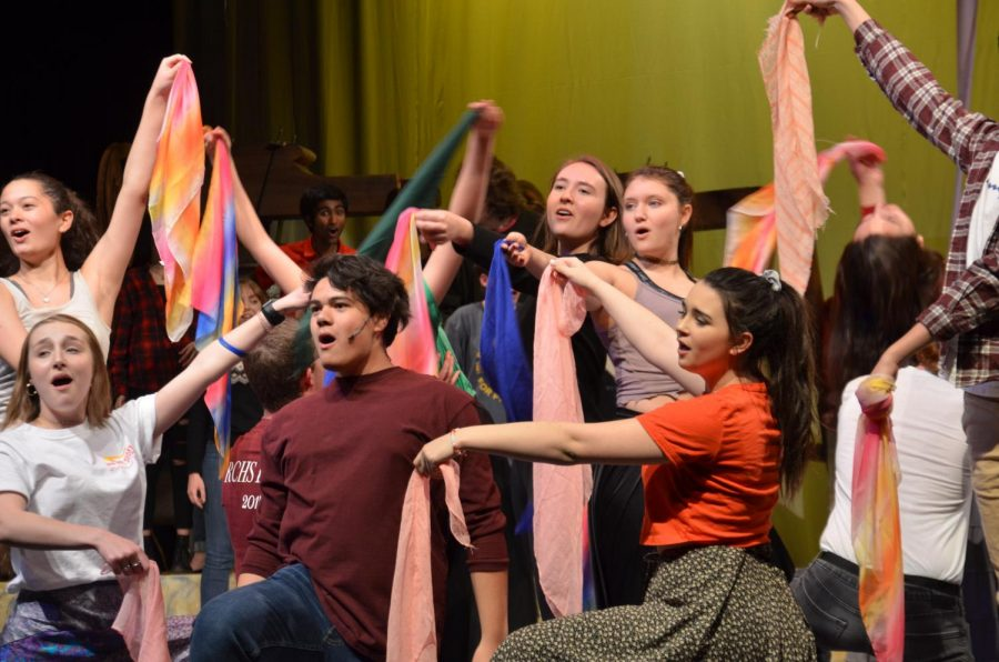 "Reese Cruz '20 dances along to ""Topsy Turvy"" as he sings in the auditorium during a rehearsal for Hunchback of Notre Dame Feb. 24. Cruz plays Clopin, the leader of the gypsies and also the narrator of the story."