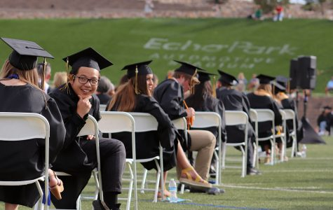 """Jimmy Lam '20 converses with his fellow graduates before the graduation ceremony begins at Echo Park June 27. Due to the outbreak of COVID-19, graduation was postponed from its original date in May. """"It was nice to see everyone one last time before we all go different ways and start new lives,"""" Taylor Eubanks '20 said."""