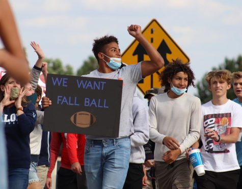 Jordan Norwood 23 and a group of Valor students cheers at the intersection of University and Colorado, to protest CHSAA's decision to keep football in the spring of 2021 Sept. 11. Let CO Play organized three protests throughout the state. All starting at 3:30, the protests occurred in Highlands Ranch, Colorado Springs and Delta.