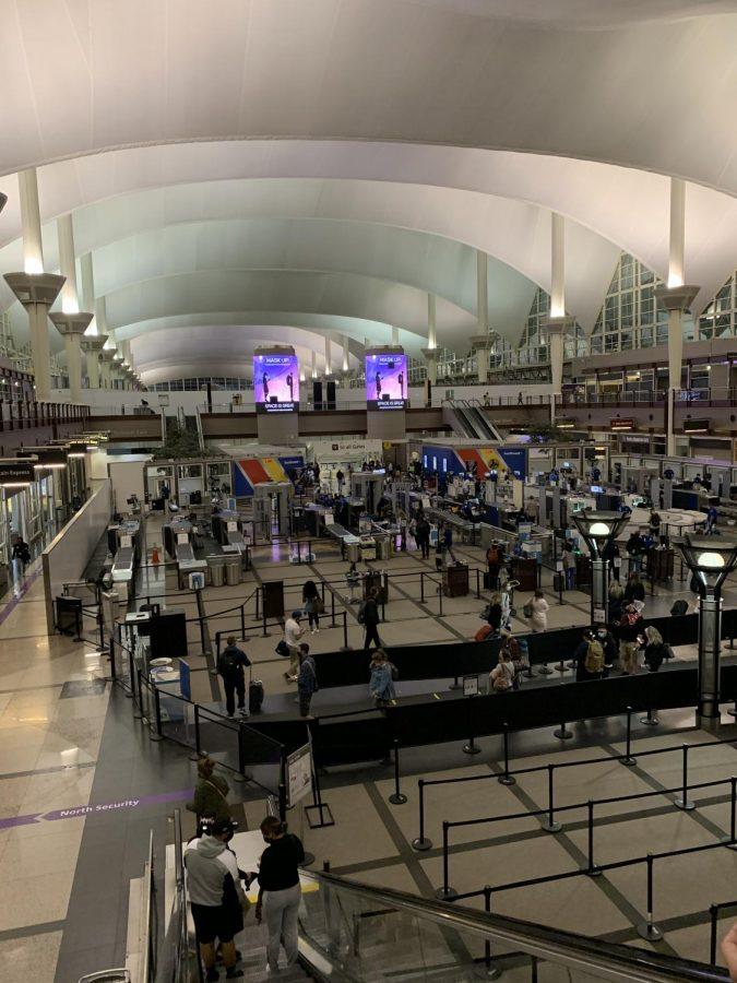 Socially-distanced travelers wait in Denver International Airport's main security line, Nov. 6.