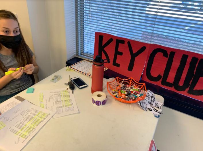 Rachel Geis '23 sits at the Vitalent donation center with Key Club posters. 21 donations were made through the Key Club, saving a total of 81 lives.