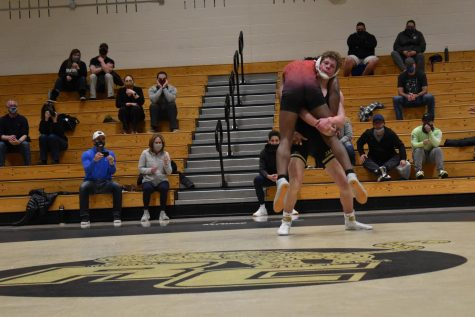 "Jack Cuthbert '22 lifts his opponent during his match Feb. 20. Cuthbert lifted his opponent several times before losing his match. ""It's tough coming back from two weeks of quarantine but you just got to give it all you got,"" Cuthbert said."