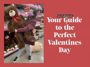 """Karisma Leung '22 holds up a giant teddy bear in King Soopers Feb. 13. The shelves were stocked with different sizes of bears and other stuffed animals to market Valentine's Day presents. """"I think Valentine's Day is really cool because we get to give each other kind or funny gifts,"""" Leung said."""