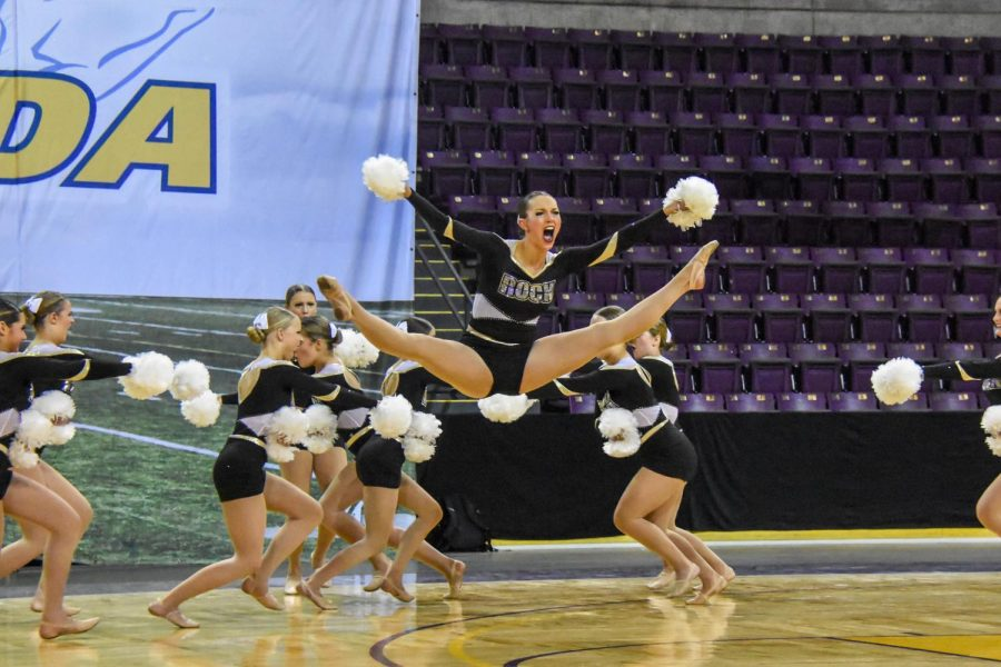 Aalyiah Kikumoto '22 jumps during the Varsity Poms team State performance.