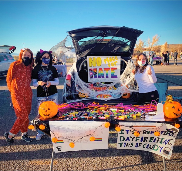 "Piper Smith '24, Alisha Pravasi '21, and Sara Smith '21 pose for a photo at No Place For Hate's Truck or Treat stand. ""I hope this club decreases the number of bullies and increases the number of positive students!"" Smith '24 said. ""It really makes a difference to people when you see them feel so confident about themselves. The members work very hard to make sure this happens."""