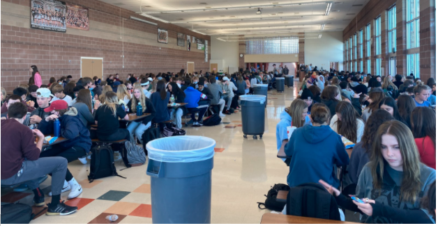 Due to the transition from a hybrid to in-person schedule, twice the number of students that have been in school all year together gather in the cafeteria to eat during their second lunch period March 30, 2021