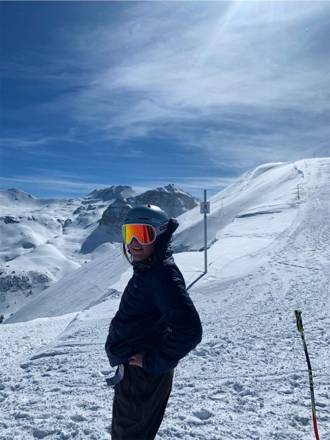 Adrienne Markey '21, stands at the summit of Telluride, getting ready to ski down the mountain Feb. 14.
