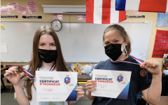Abigal Benko '23 and Lauren Vick '24 pose with their winnings from Grand Concours.