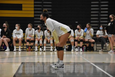 Alivia Eikenberg 25 prepares to play the next point on Sept. 8 at the game against Arapahoe Highschool. Eikenberg prepared to pass the serve receive ball while she played back row.