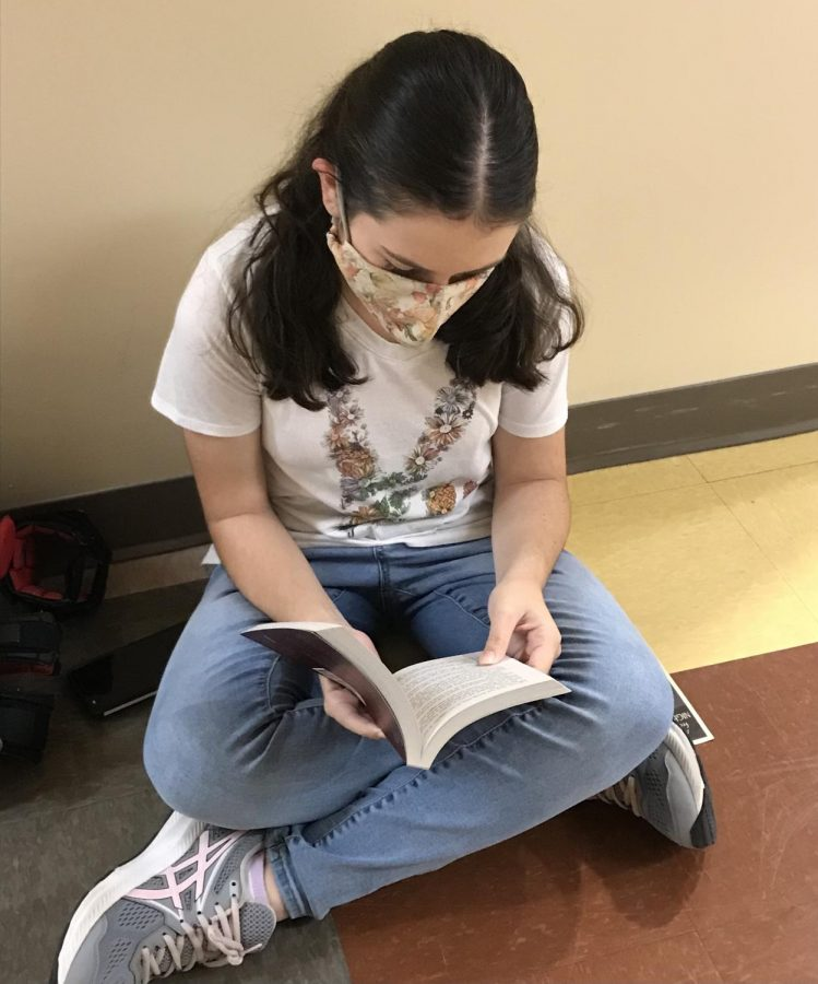 Sophia Miller 25 reads Percy Jackson and the Olympians before school  on Oct. 7.