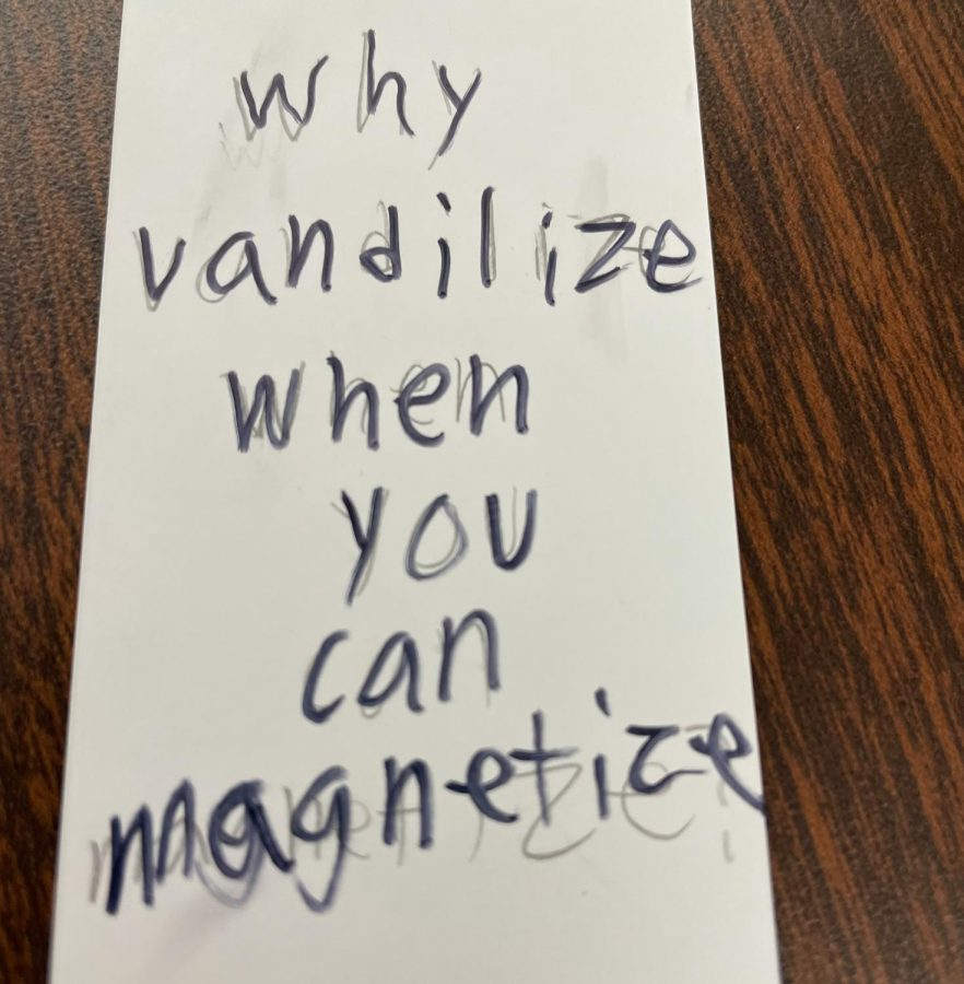 A sign on one of the restroom stalls says, Why vandilize when you can magnetize.
